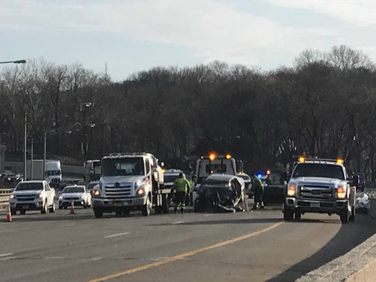 Rescue workers remove one of the cars involved in a fatal crash Sunday morning on Route 80 in Woodland Park. The crash occurred on the west bound side near the bridge that crosses the Passaic River.