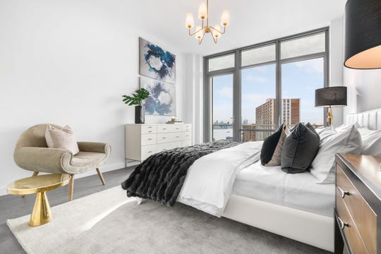 The 1,427-square-foot penthouses at One Park, include two large bedrooms featuring impressive views from the top of the 14-story building.