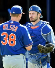 Feb 15, 2019; Port St. Lucie, FL, USA; New York Mets catcher Travis d'Arnaud (right) talks with Mets starting pitcher Justin Wilson (left) during spring training at First Data Field.