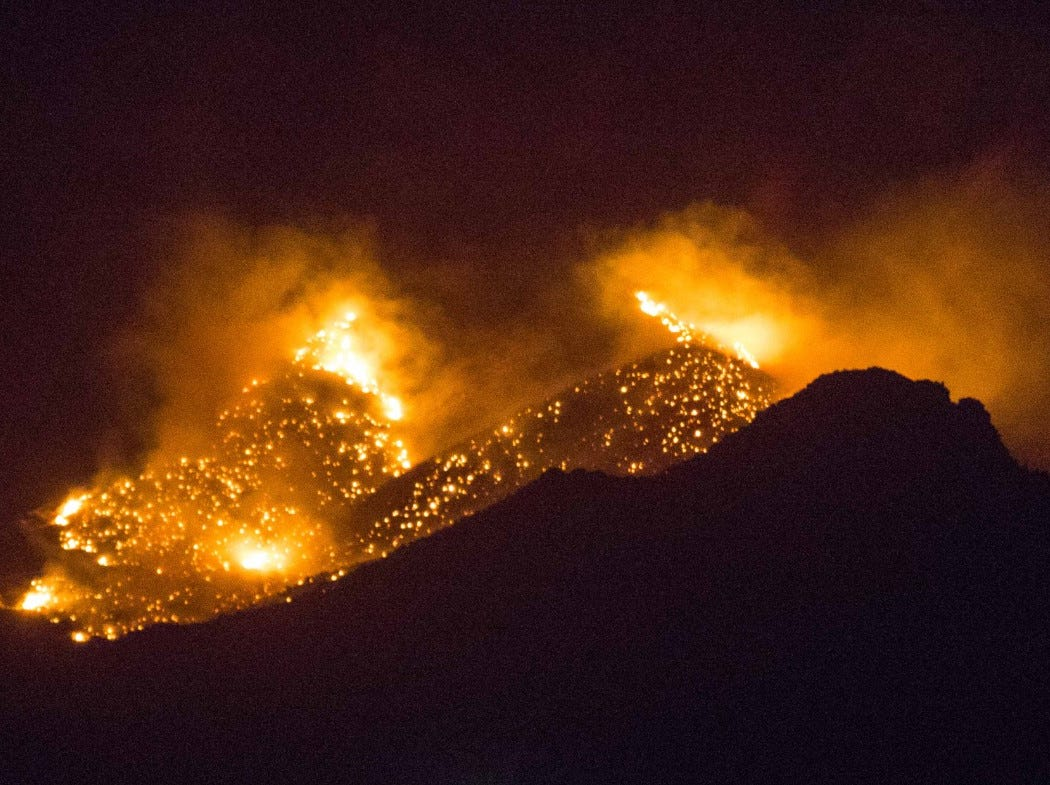 A large brush fire burns north of Baylor Canyon in the Organ Mountains on Saturday, March 2, 2019.