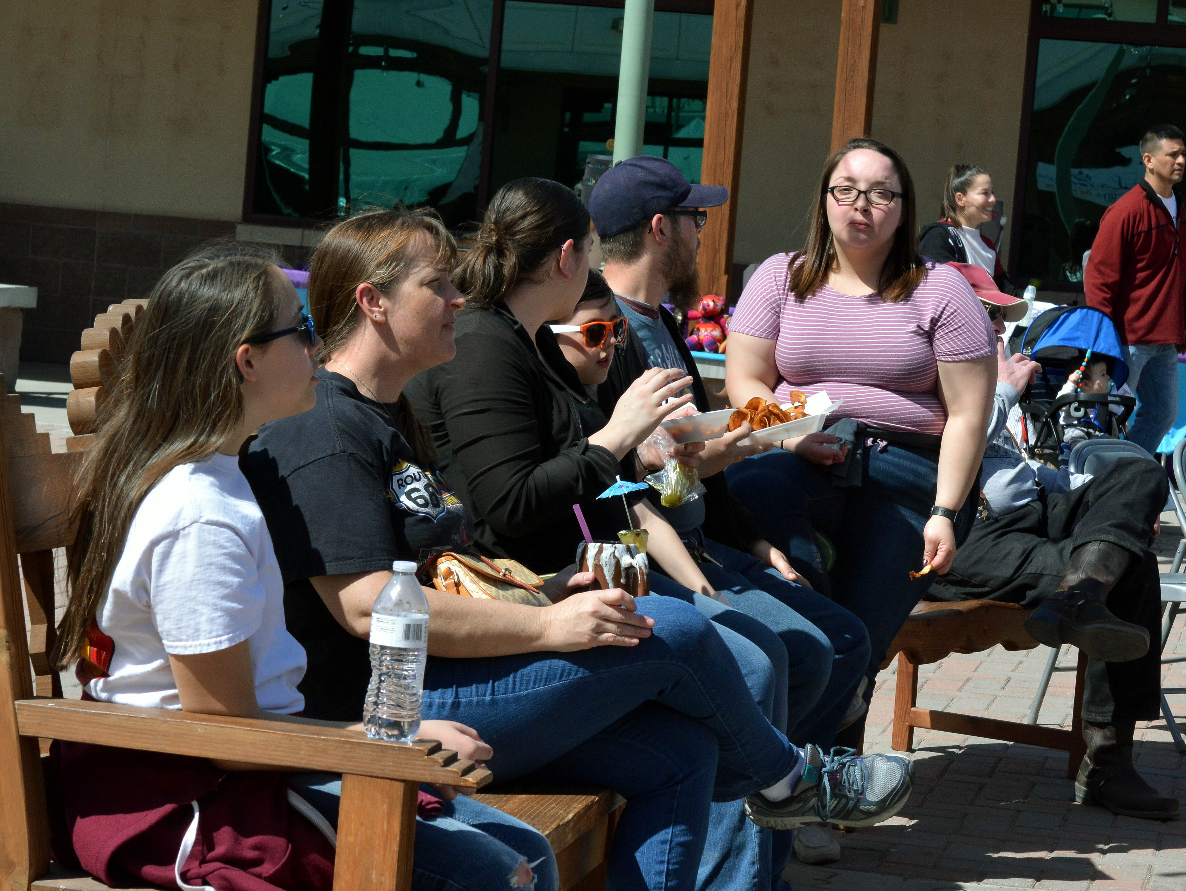 People gather in the courtyard of the New Mexico Farm and Ranch Heritage Museum to eat and listen to music at the 20th annual Cowboy Days on Saturday, March 2, 2019.