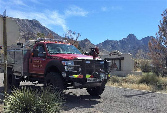 An Organ Fire Department truck waits at the corner of Baylor Canyon Road and Los Vaqueros Drive on Sunday, March 3, 2019. Saturday afternoon, firefighters from Organ were first to respond to the Baylor Canyon Fire in the Organ Mountains.