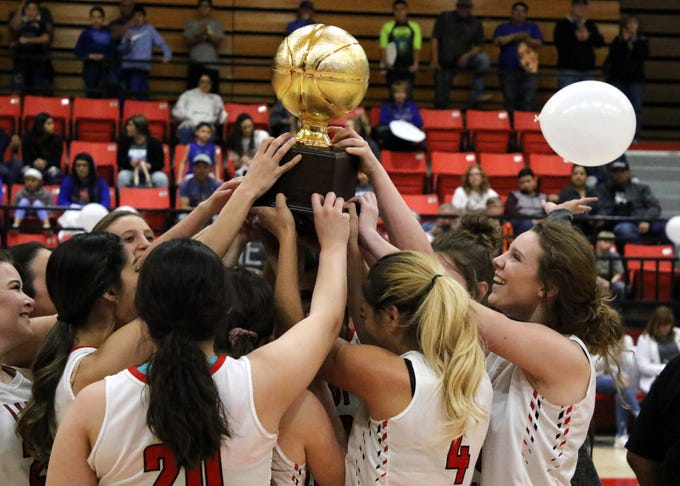 The Lady Falcons hoist up the Class 4-2A district title after beating Jal, 67-47 on Saturday.