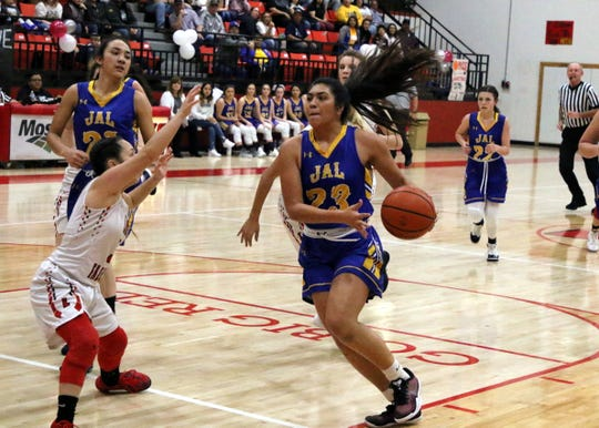 Jal senior Jocelyn Hernandez drives the lane in the first quarter of Saturday's Class 4-2A district championship game against Loving. She finished with eight points and Loving won, 67-47.