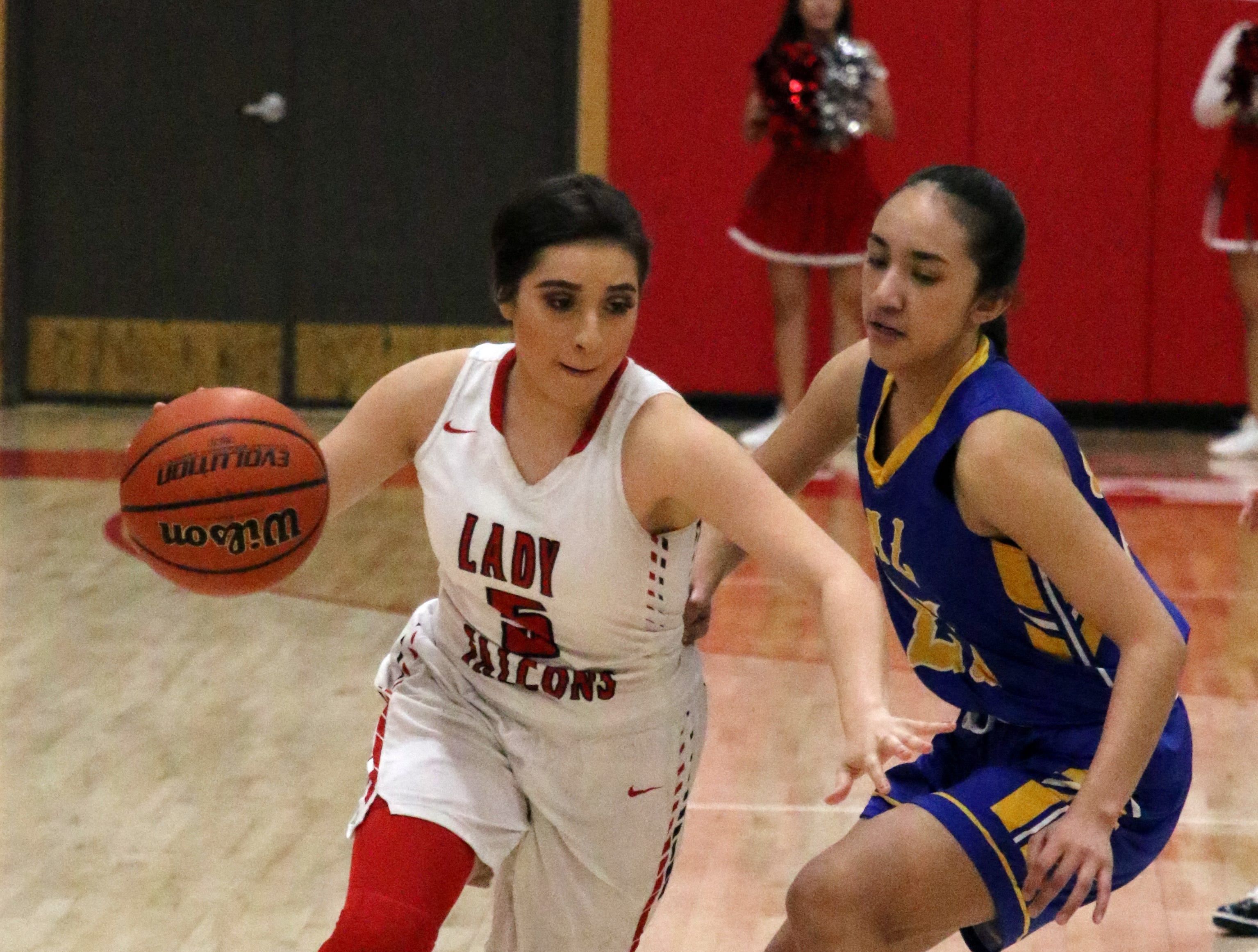 Anyssa Rodriguez drives by a Jal defender in the first quarter of Saturday's Class 4-2A district title game.