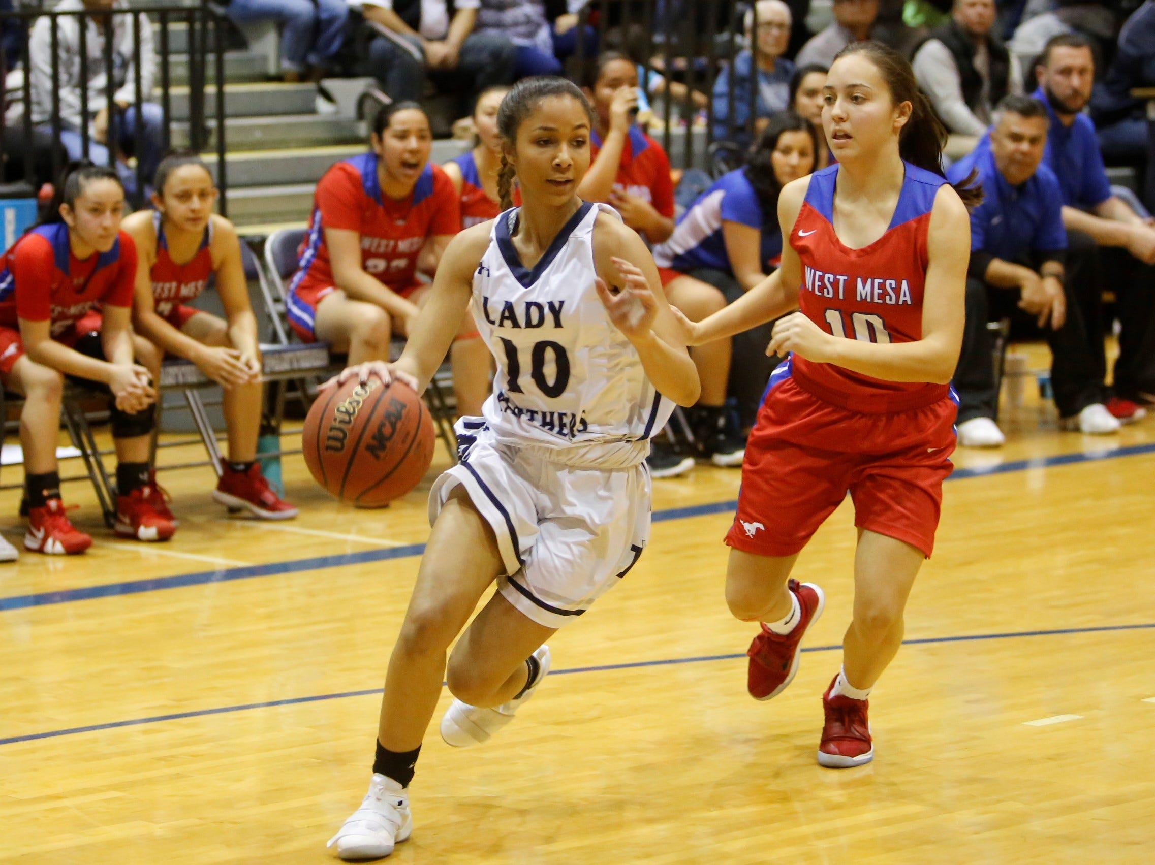 Piedra Vista's Olivia Watson drives toward the basket against West Mesa's Jeniffer Martinez during Saturday's District 2-5A tournament championship game at Jerry A. Conner Fieldhouse in Farmington.