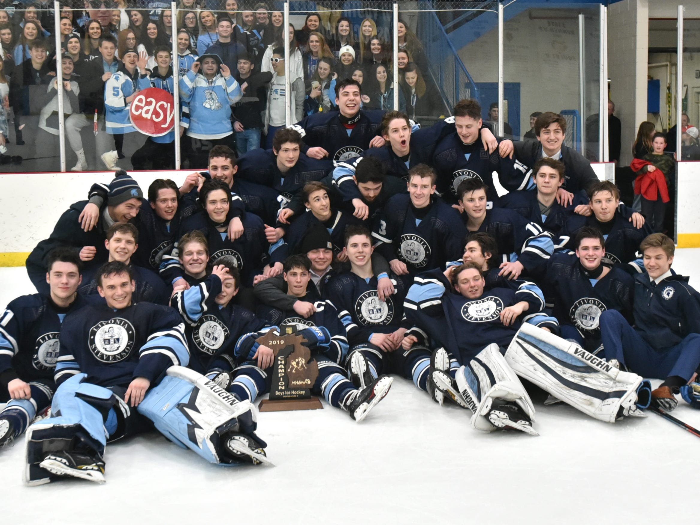 The Livonia Stevenson Spartan hockey team poses with their MHSAA regional trophy after defeating Howell 3-0 on March 2.