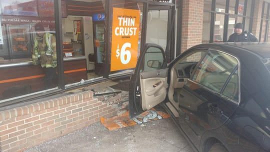 The aftermath of a car ramming into the front of the Canton Little Caesars on Canton Center Rd.