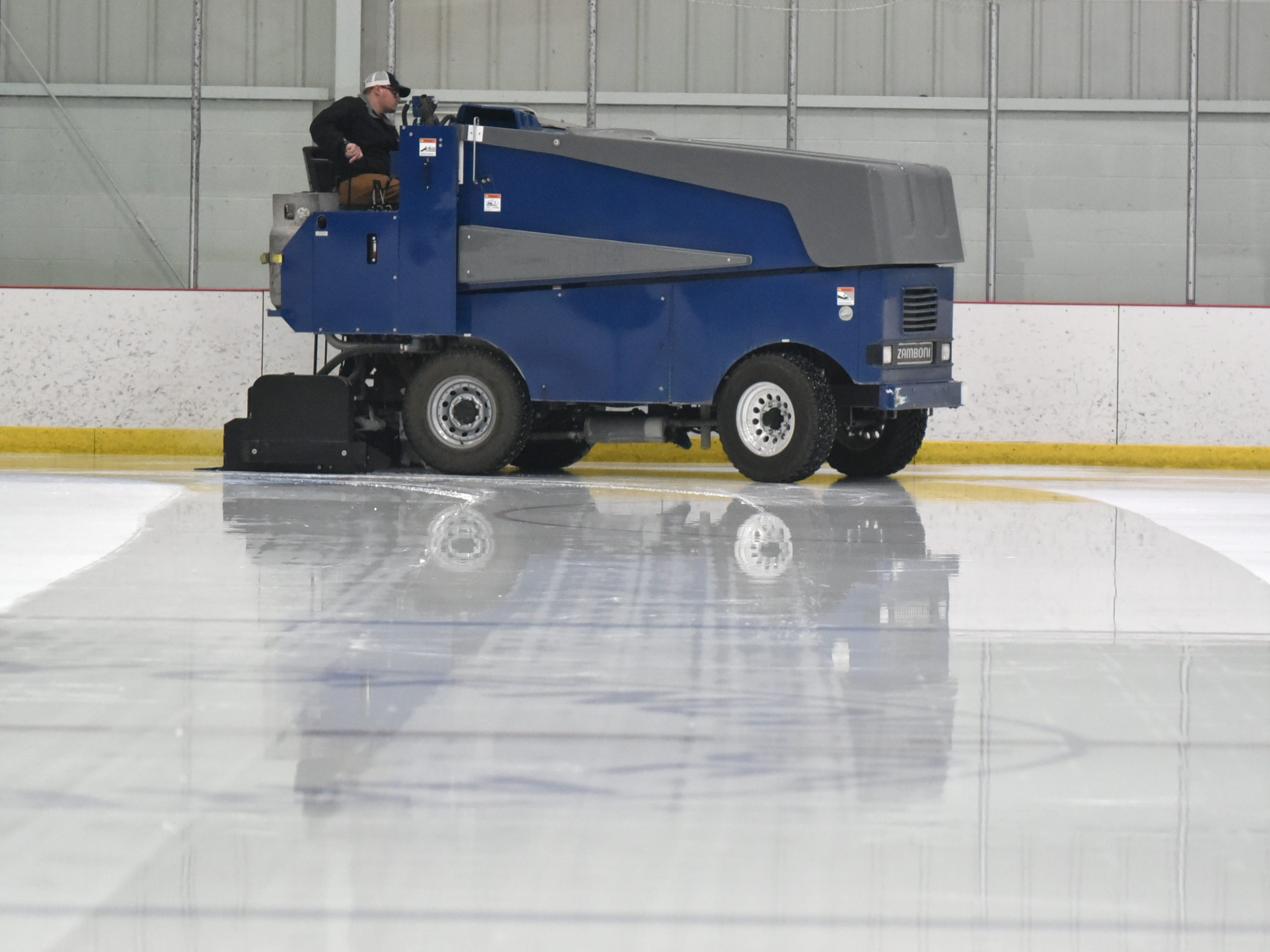 A Zamboni driver re-surfaces the ice at the Novi Ice Arena on March 2 before the start of MHSAA boys regional ice hockey playoff game.