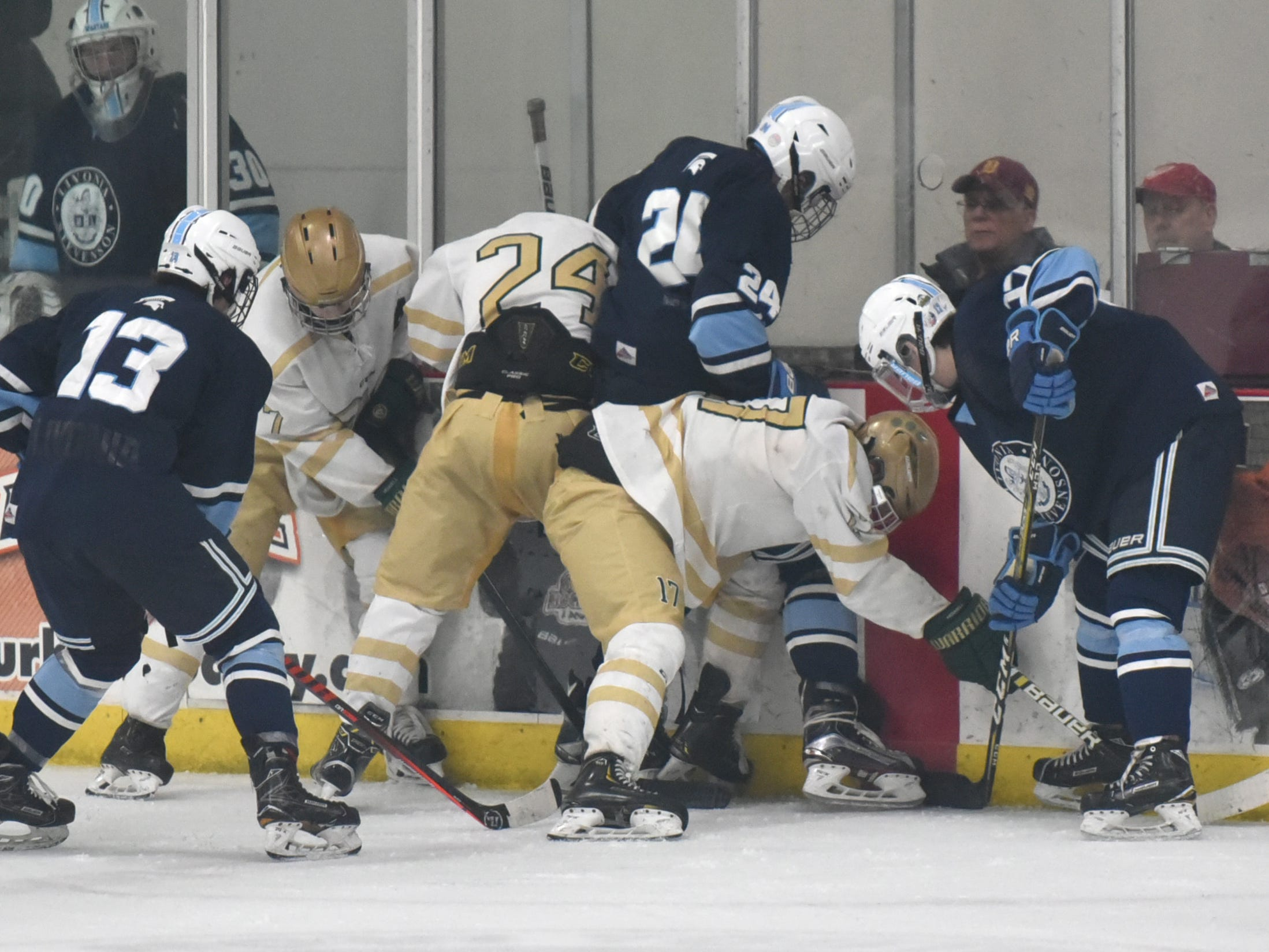 A large scrum for the puck involving six players took about thirty seconds to clear.