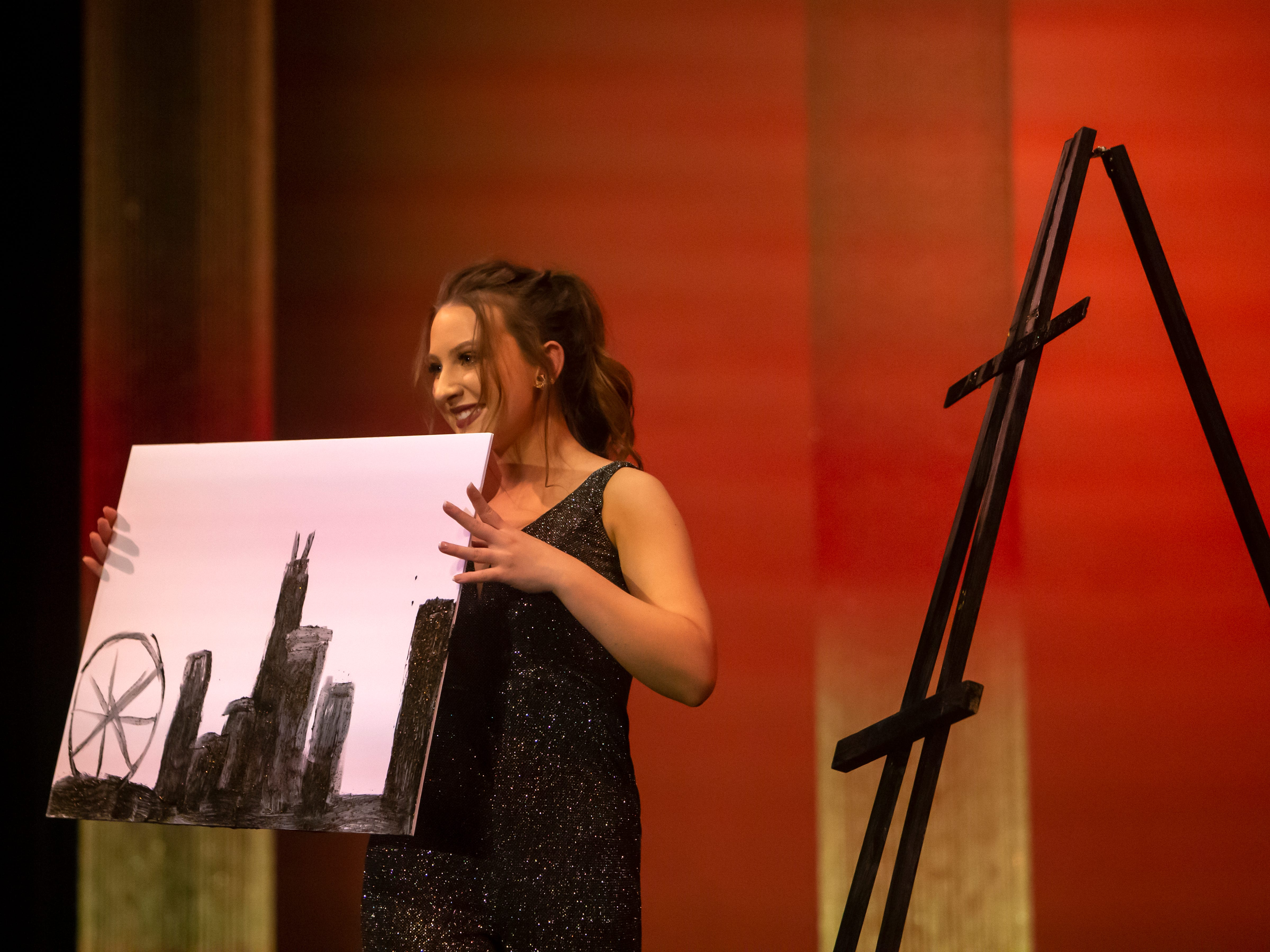 Meghan Selenka draws a piece of art during the Miss Oshkosh's Outstanding Teen portion of the scholarship pageant Saturday, March 2, 2019, at Alberta Kimball Auditorium in Oshkosh, Wis.