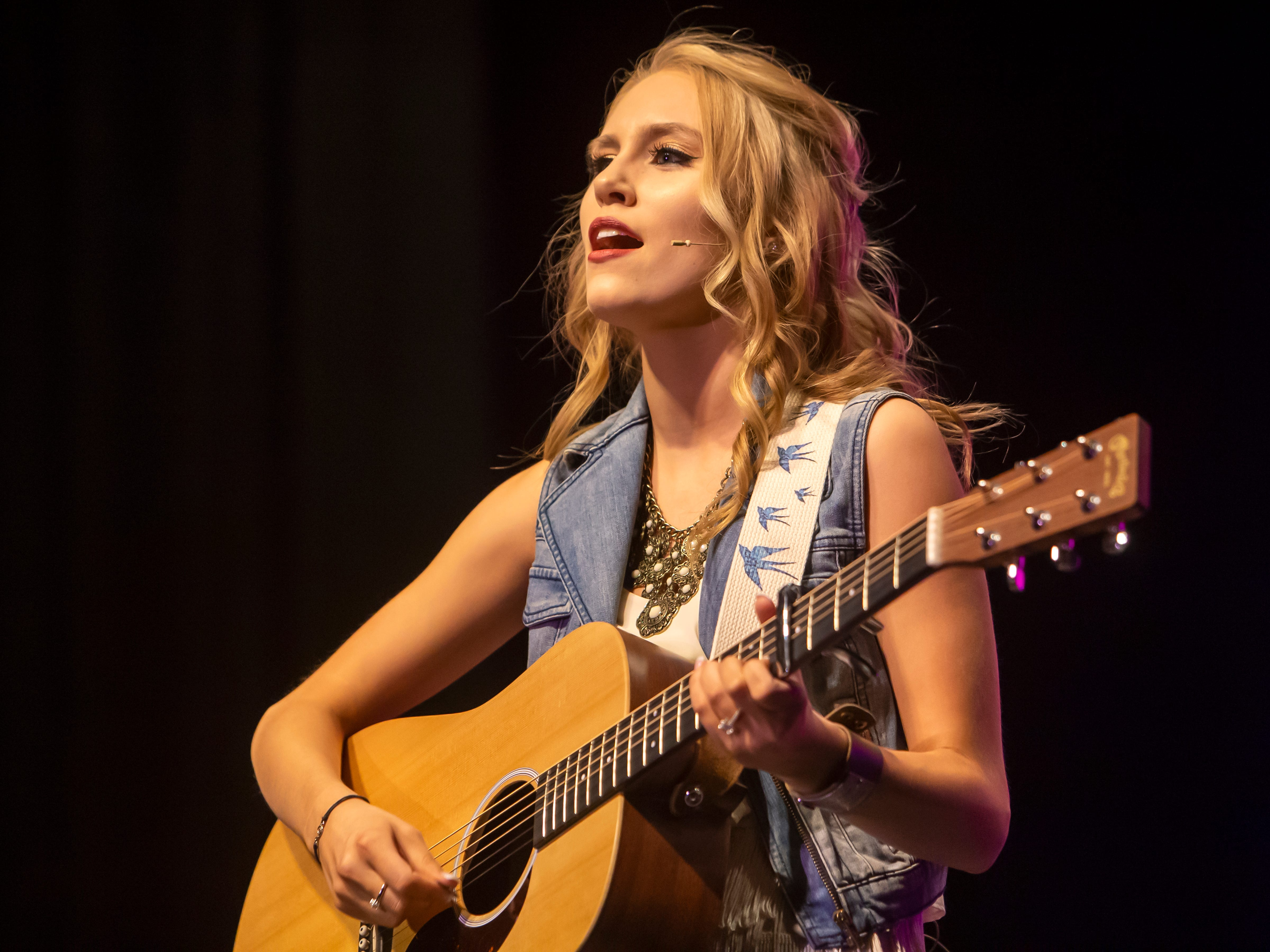 Cari Beilfuss sings and plays guitar in the talent portion of the Miss Oshkosh Scholarship Pageant Saturday, March 2, 2019, at Alberta Kimball Auditorium in Oshkosh, Wis.