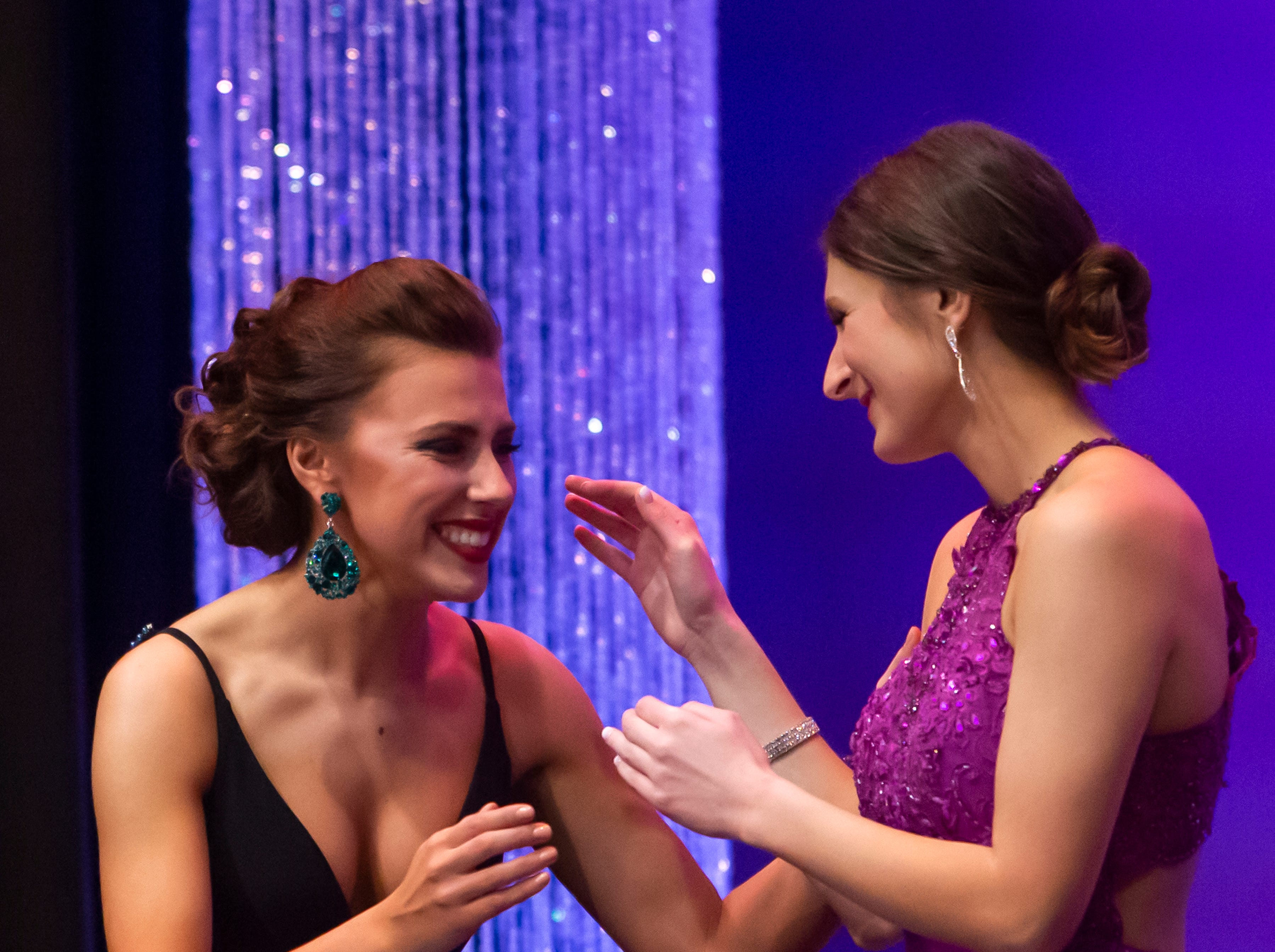 Anna Chapin reaches to Katrina Mazier congratulating Mazier on her Miss Oshkosh title win during the Miss Oshkosh Scholarship Pageant Saturday, March 2, 2019, at Alberta Kimball Auditorium in Oshkosh, Wis.