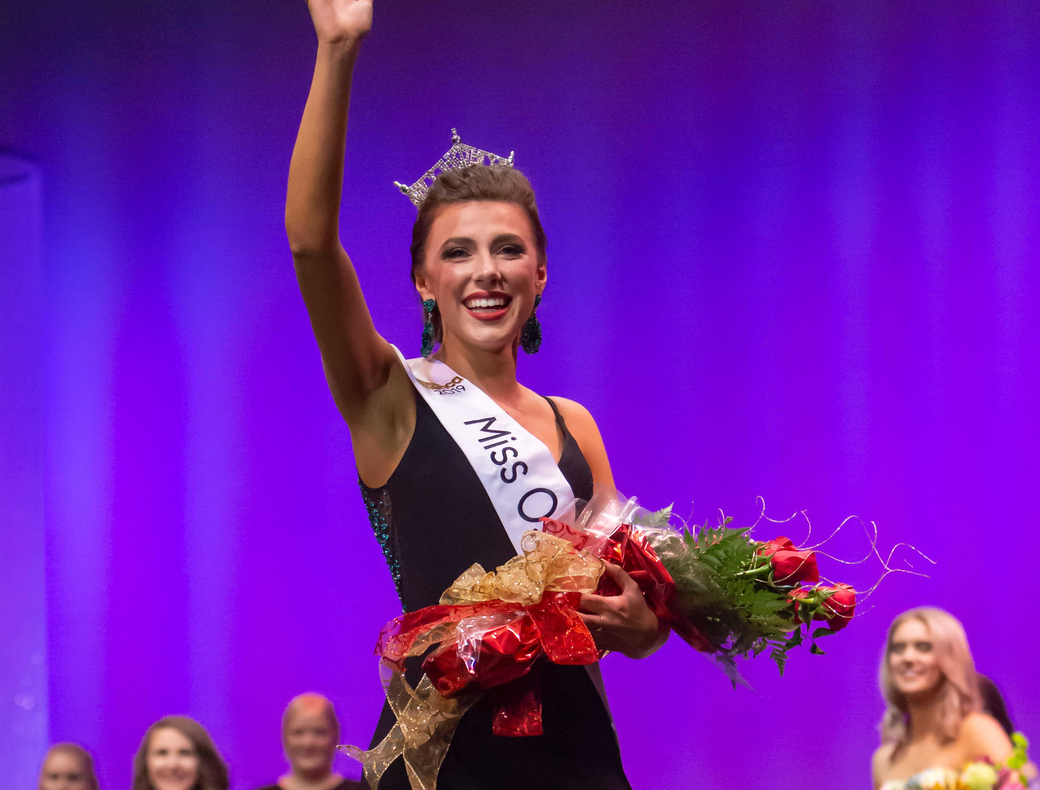 Katrina Mazier waves to the audience as the new Miss Oshkosh 2019 during the Miss Oshkosh Scholarship Pageant Saturday, March 2, 2019, at Alberta Kimball Auditorium in Oshkosh, Wis.