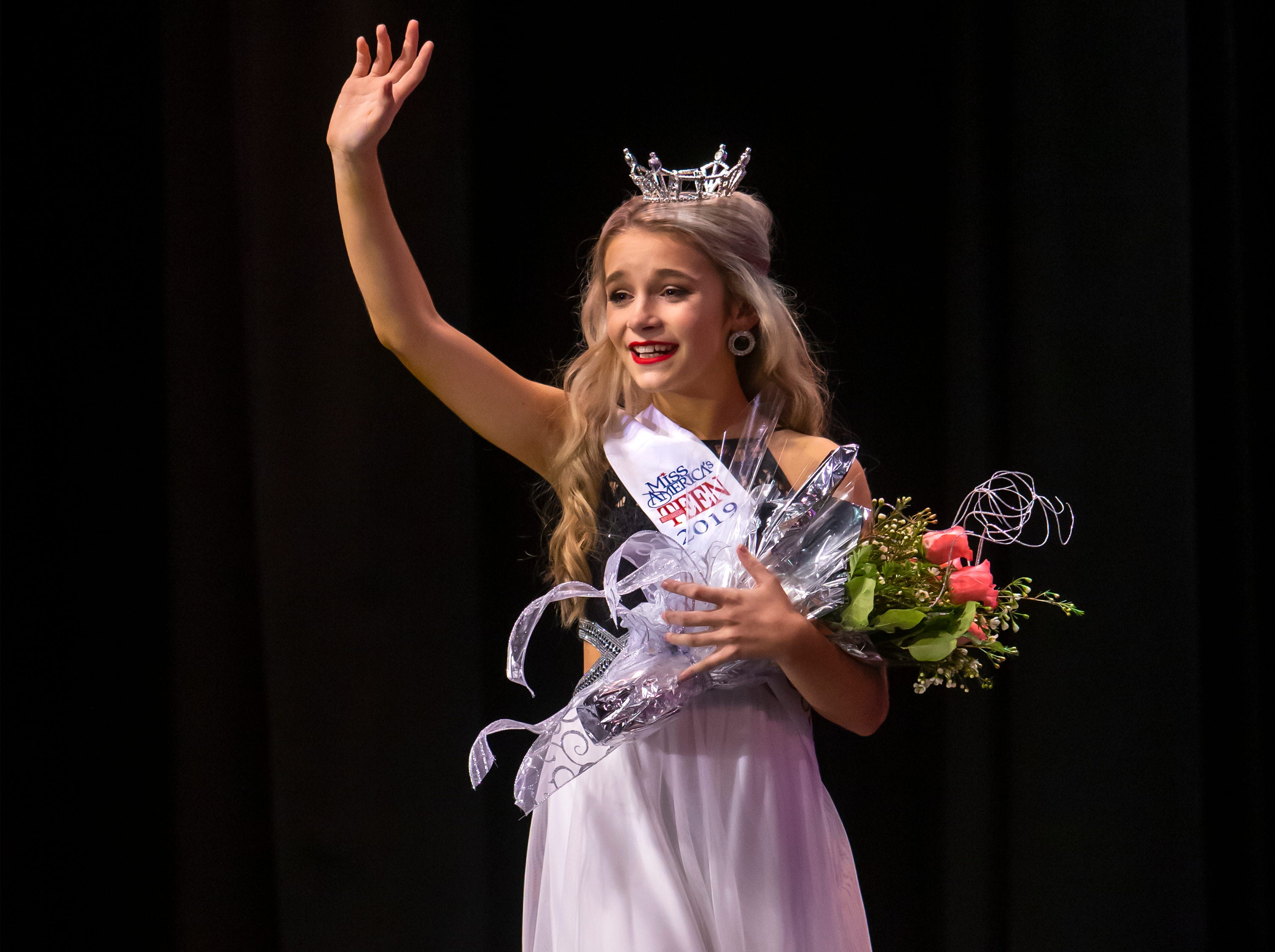 Samantha Tuchscherer wins the Miss Oshkosh's Outstanding Teen title during the Miss Oshkosh Scholarship Pageant Saturday, March 2, 2019, at Alberta Kimball Auditorium in Oshkosh, Wis.