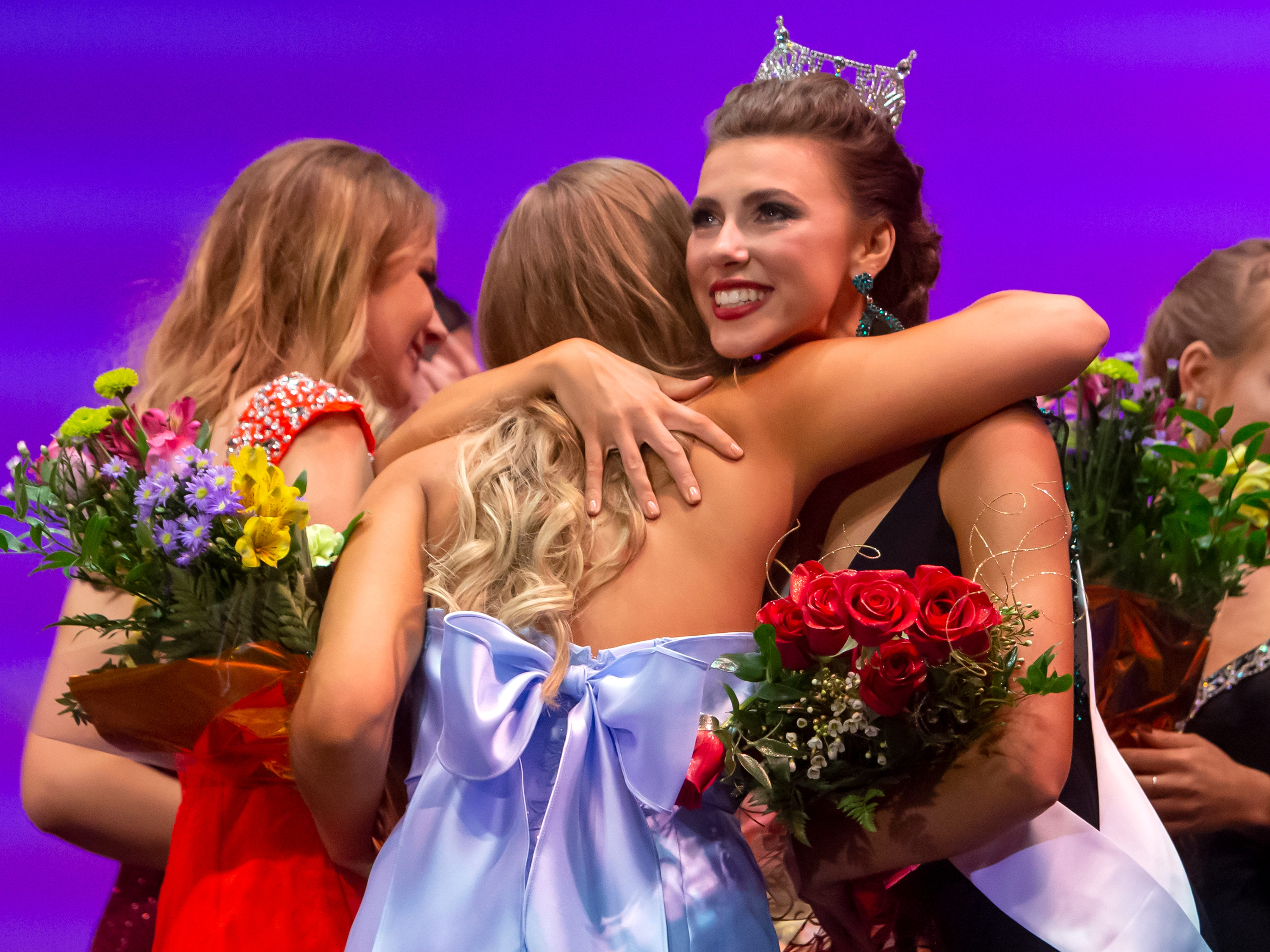 Katrina Mazier receives congratulations winning the Miss Oshkosh crown during the Miss Oshkosh Scholarship Pageant Saturday, March 2, 2019, at Alberta Kimball Auditorium in Oshkosh, Wis.