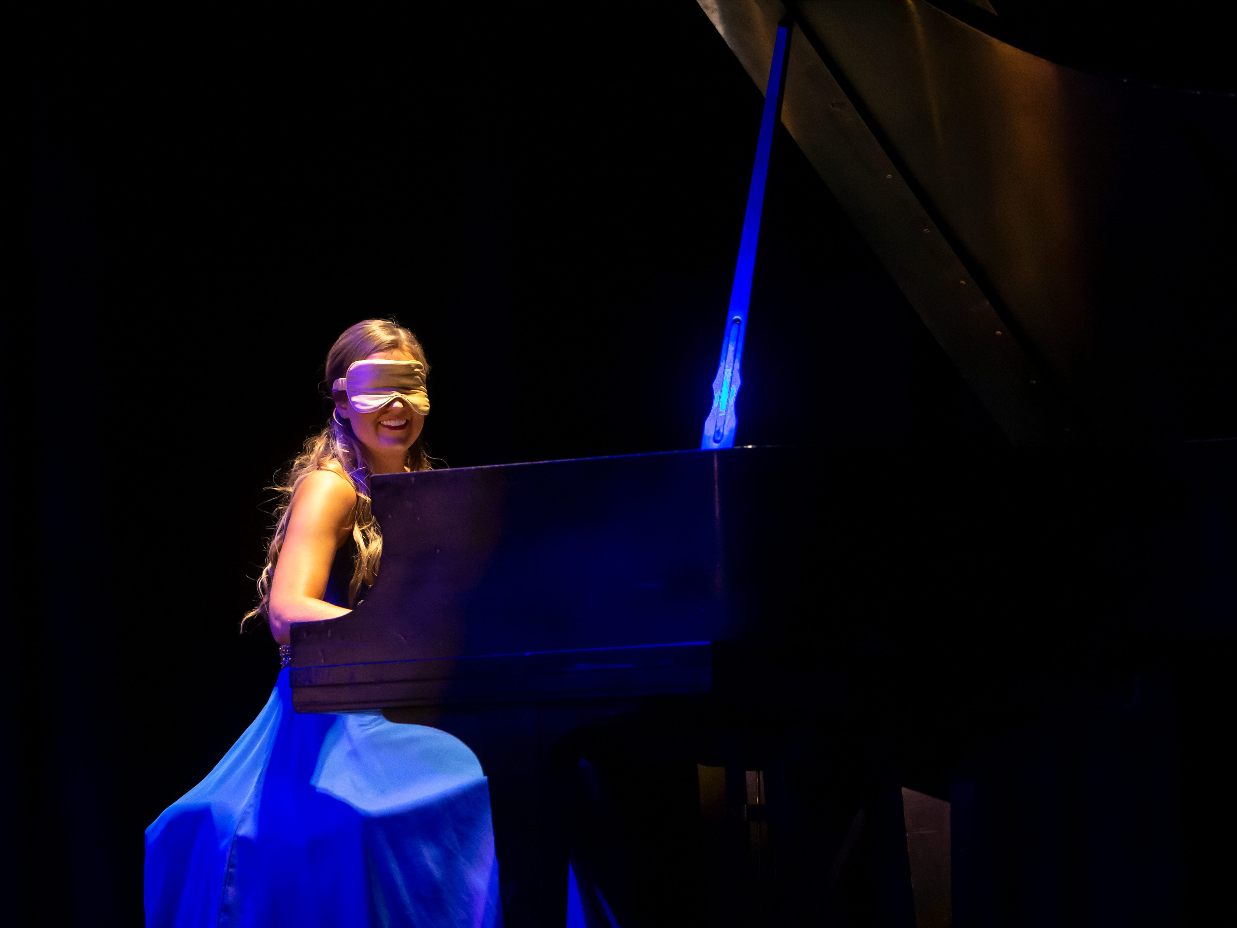 Hannah Krueger performs a piano piece blindfolded during the Miss Oshkosh Scholarship Pageant Saturday, March 2, 2019, at Alberta Kimball Auditorium in Oshkosh, Wis.