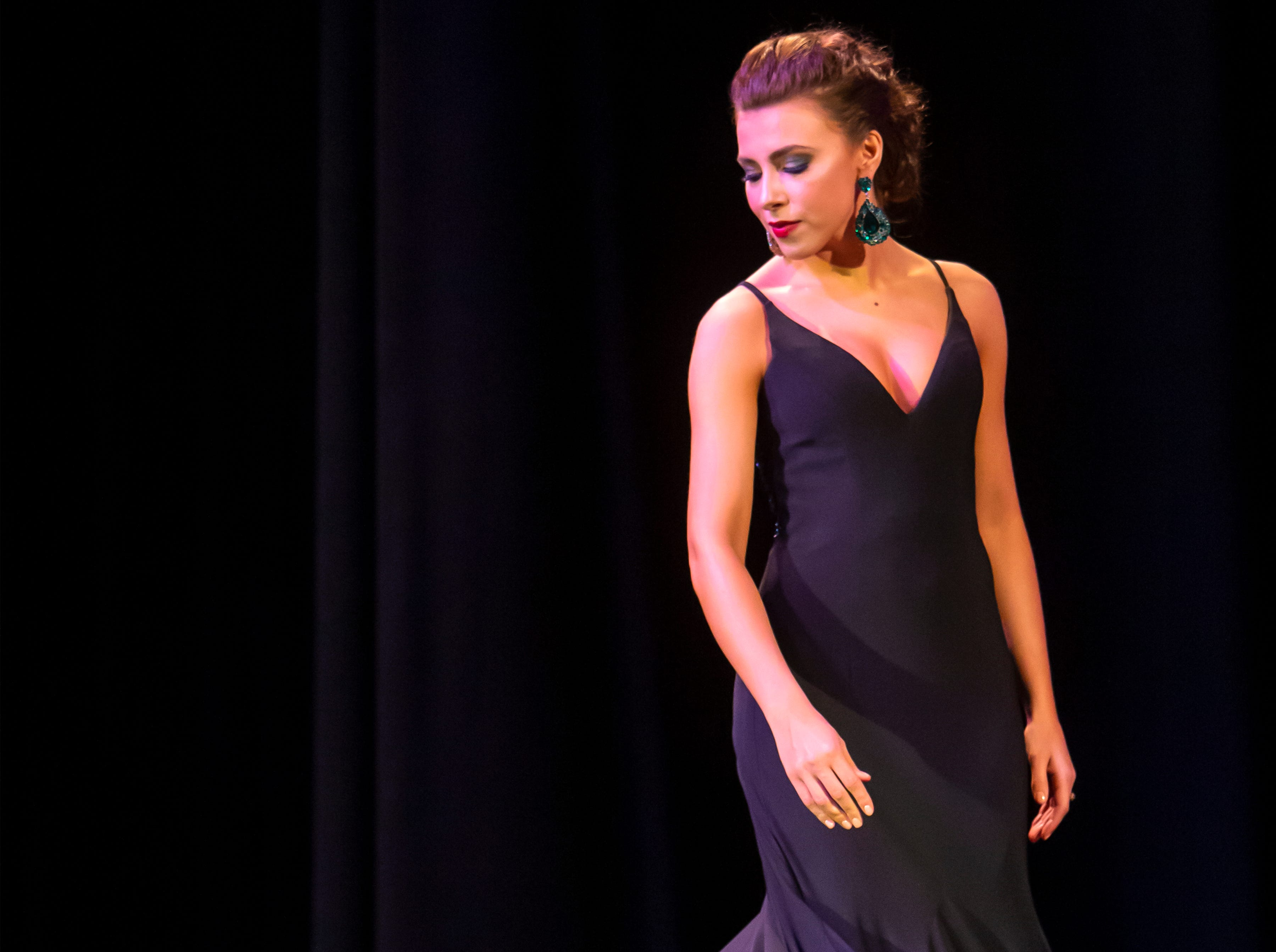 Katrina Mazier competes in the evening wear portion of the Miss Oshkosh Scholarship Pageant Saturday, March 2, 2019, at Alberta Kimball Auditorium in Oshkosh, Wis.