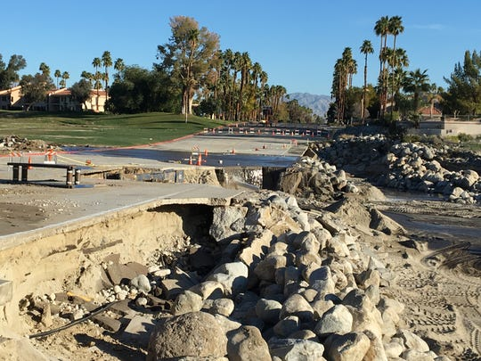 A Feb. 14 storm destroyed Cathedral Canyon Drive at the Whitewater Wash in Cathedral City. Officials haven't announced when the road would reopen.