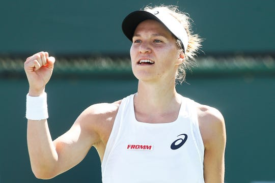 Viktorija Golubic celebrates during her Oracle Challenger Series finals victory over Jennifer Brady.