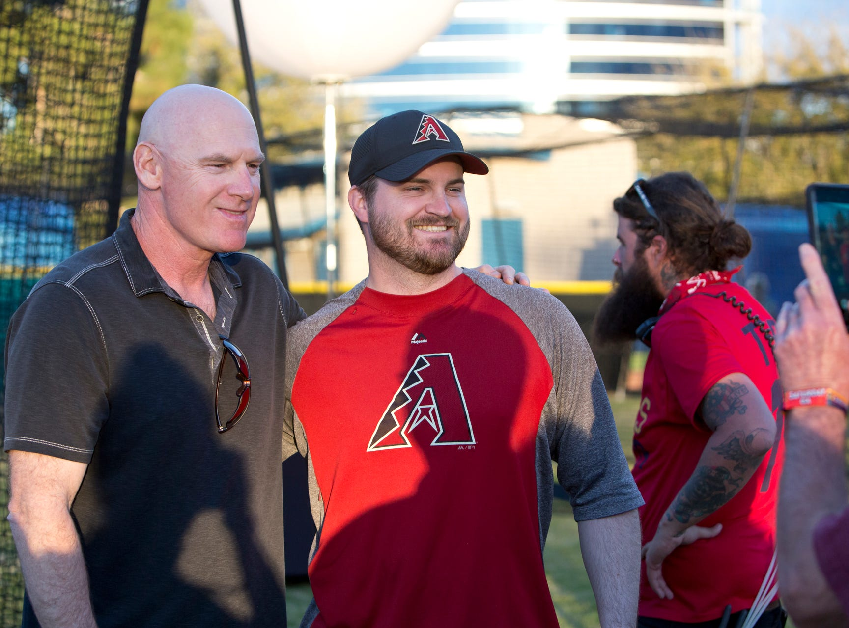 Matt Williams poses with a fan at the batting cages during the Innings Festival on March 2, 2019, at Tempe Beach Park.