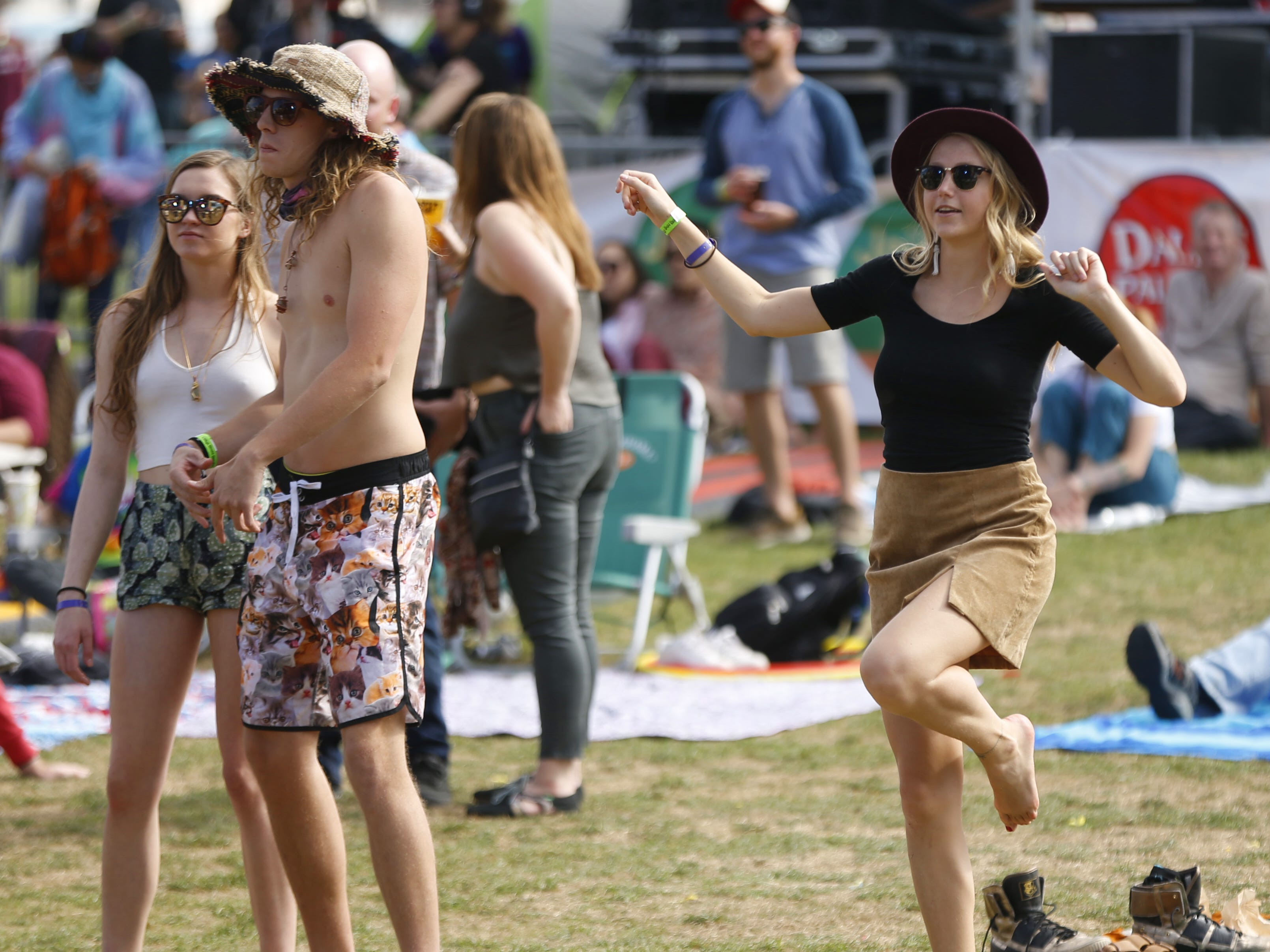 Fans dance to Phoenix Afrobeat Orchestra's music during the McDowell Mountain Music Festival in Phoenix, Ariz. on March 2, 2019.