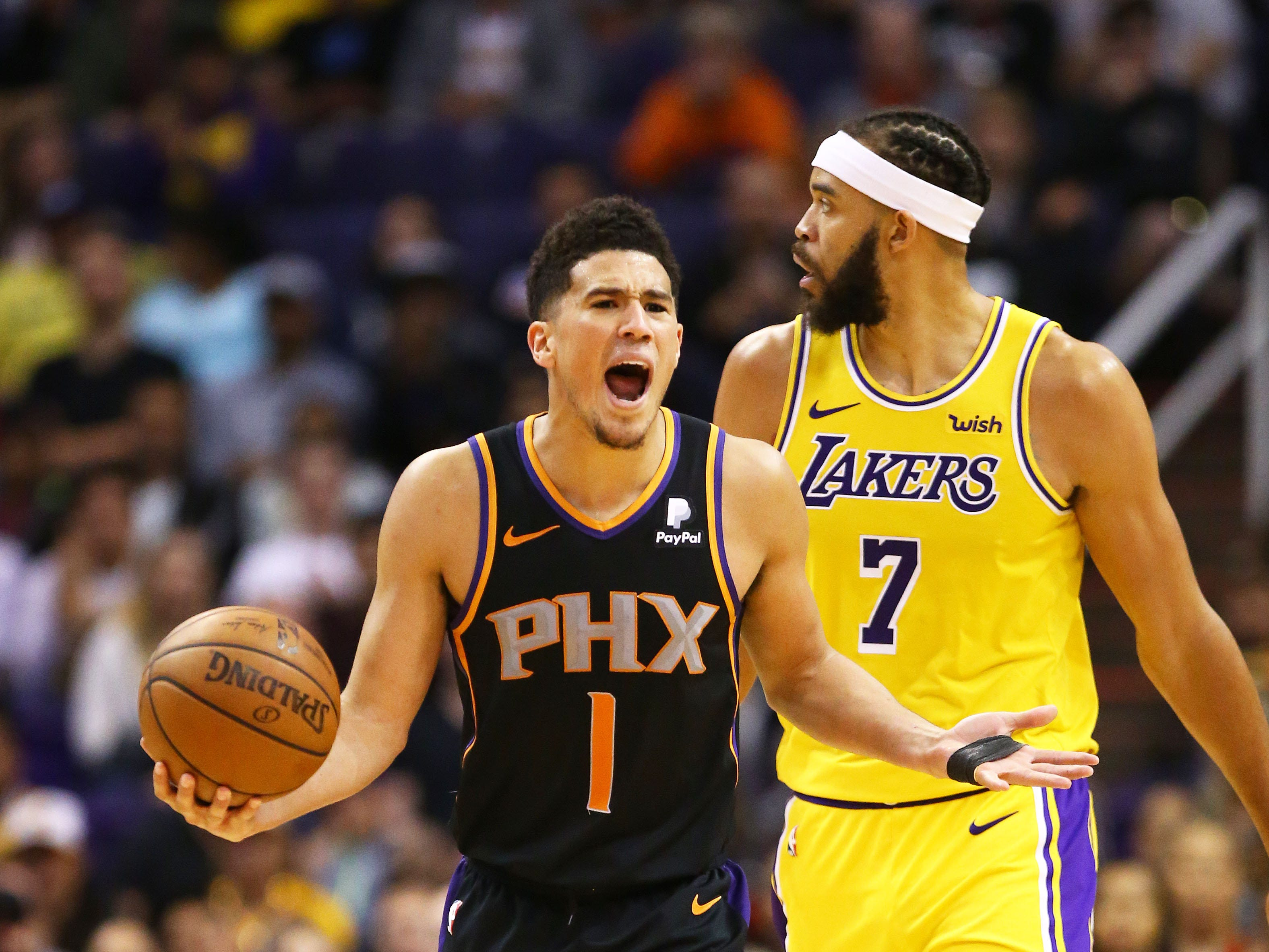 Phoenix Suns guard Devin Booker (1) reacts after being called for traveling against the Los Angeles Lakers in the second half on Mar. 2, 2019, at Talking Stick Resort Arena in Phoenix, Ariz.