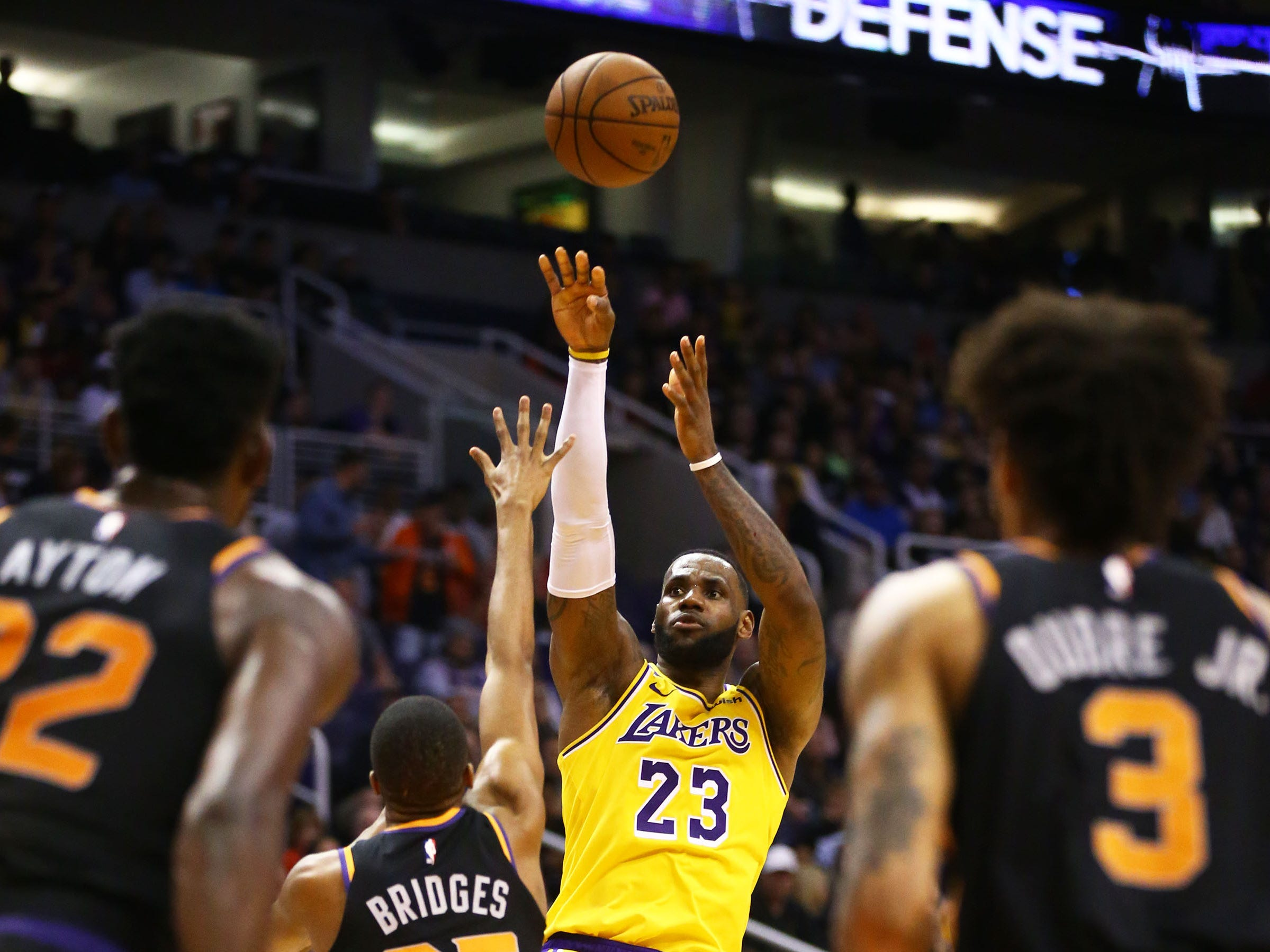 Los Angeles Lakers forward LeBron James (23) shoots a jumper over Phoenix Suns forward Mikal Bridges (25) in the second half on Mar. 2, 2019, at Talking Stick Resort Arena in Phoenix, Ariz.
