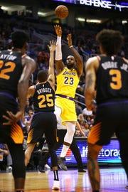 Los Angeles Lakers forward LeBron James (23) shoots a jumper over Phoenix Suns forward Mikal Bridges (25) in the second half on Mar. 2, 2019, at Talking Stick Resort Arena in Phoenix, Ariz.