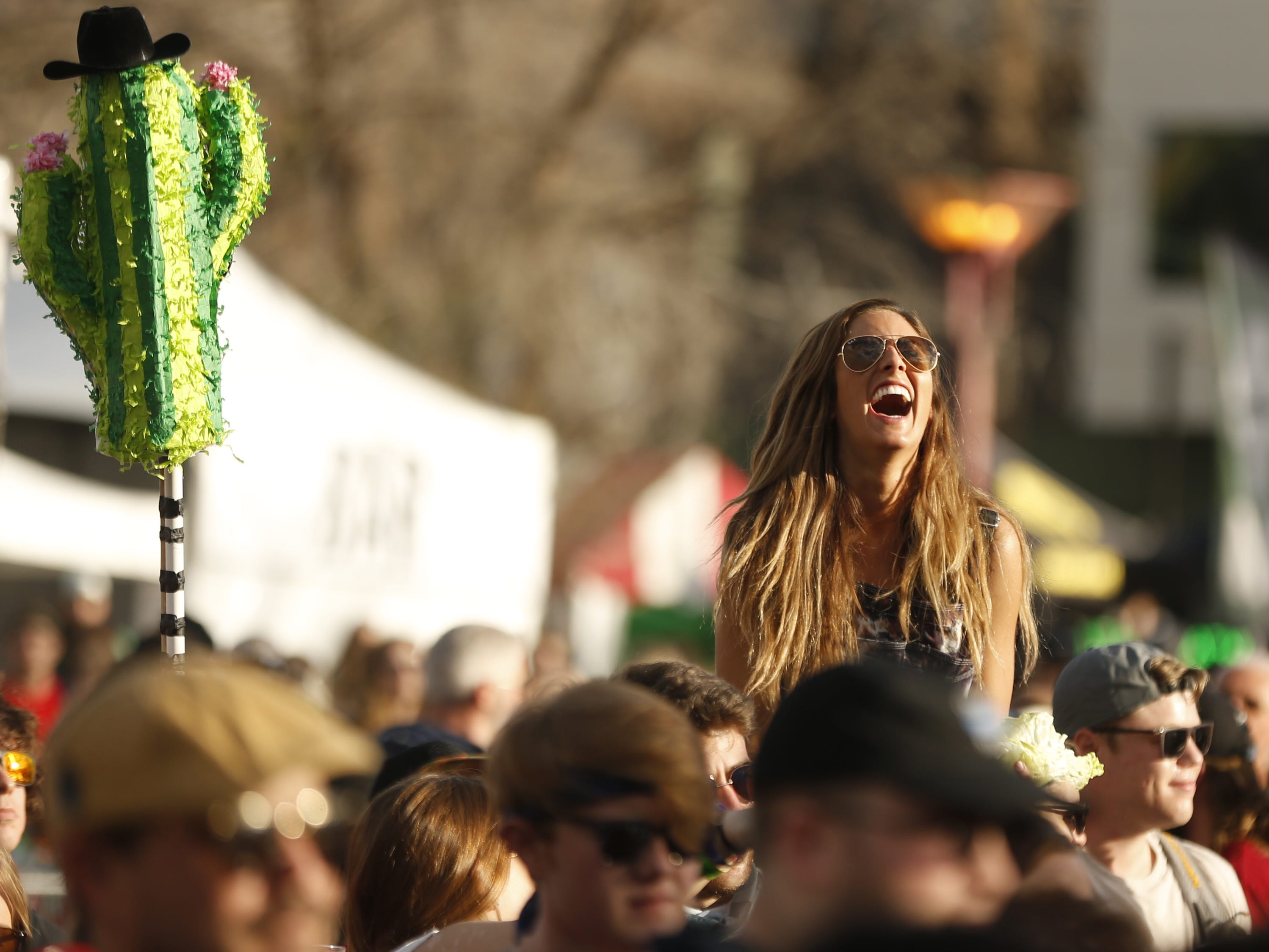 A fan laughs listen to the band Lettuce during the McDowell Mountain Music Festival in Phoenix on March 2, 2019.