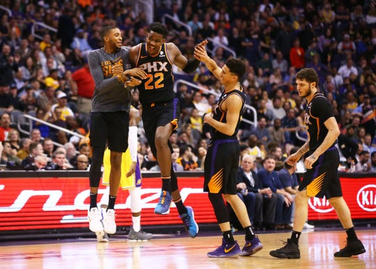 Deandre Ayton celebrates with Devin Booker after making a basket against the Lakers during a game March 2 at Talking Stick Resort Arena.