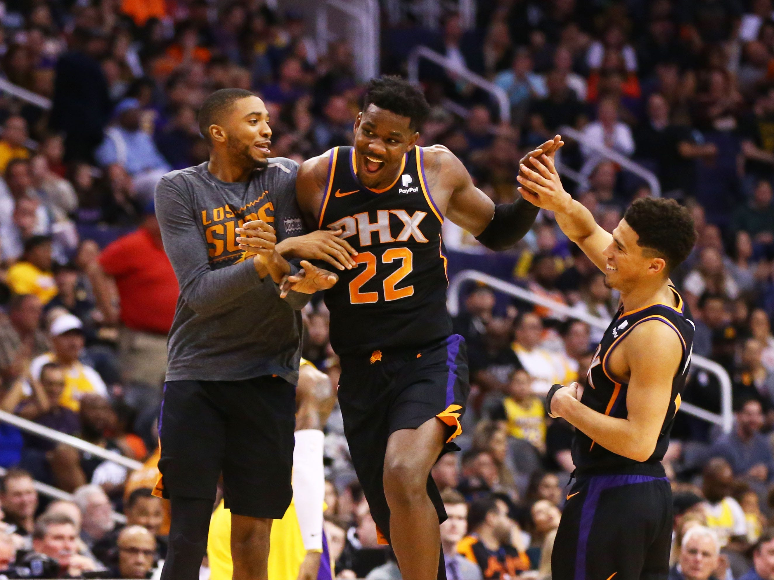 Phoenix Suns center Deandre Ayton (22) celebrates with guard Devin Booker (1) after making a basket against the Los Angeles Lakers in the second half on Mar. 2, 2019, at Talking Stick Resort Arena in Phoenix, Ariz.