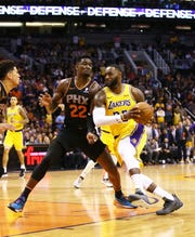 Los Angeles Lakers forward LeBron James (23) is guarded by Phoenix Suns center Deandre Ayton (22) in the second half on Mar. 2, 2019, at Talking Stick Resort Arena in Phoenix, Ariz.