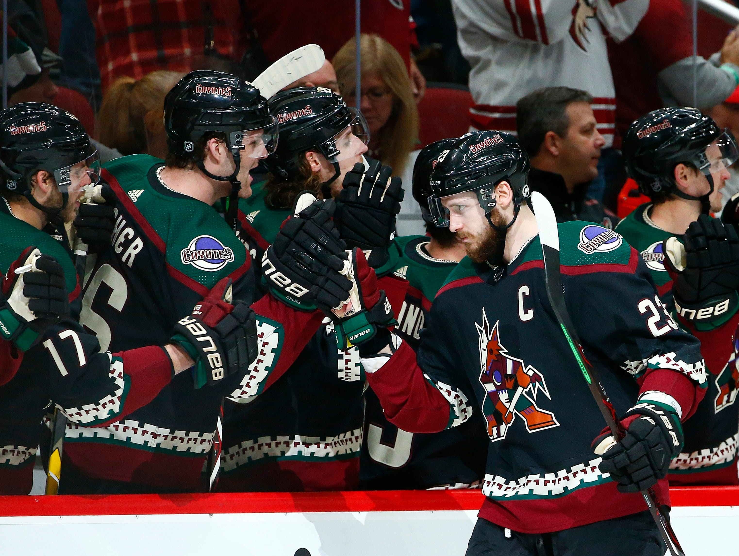 Arizona Coyotes defenseman Oliver Ekman-Larsson (23) celebrates his goal against the Detroit Red Wings with teammates on the bench during the first period Saturday, March 2, 2019, in Glendale, Ariz. (AP Photo/Ross D. Franklin)