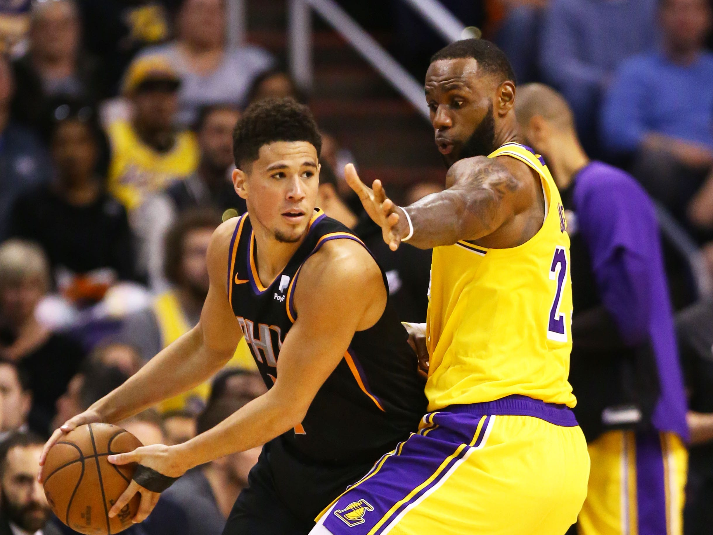 Los Angeles Lakers forward LeBron James (23) pressures Phoenix Suns guard Devin Booker (1) in the second half on Mar. 2, 2019, at Talking Stick Resort Arena in Phoenix, Ariz.