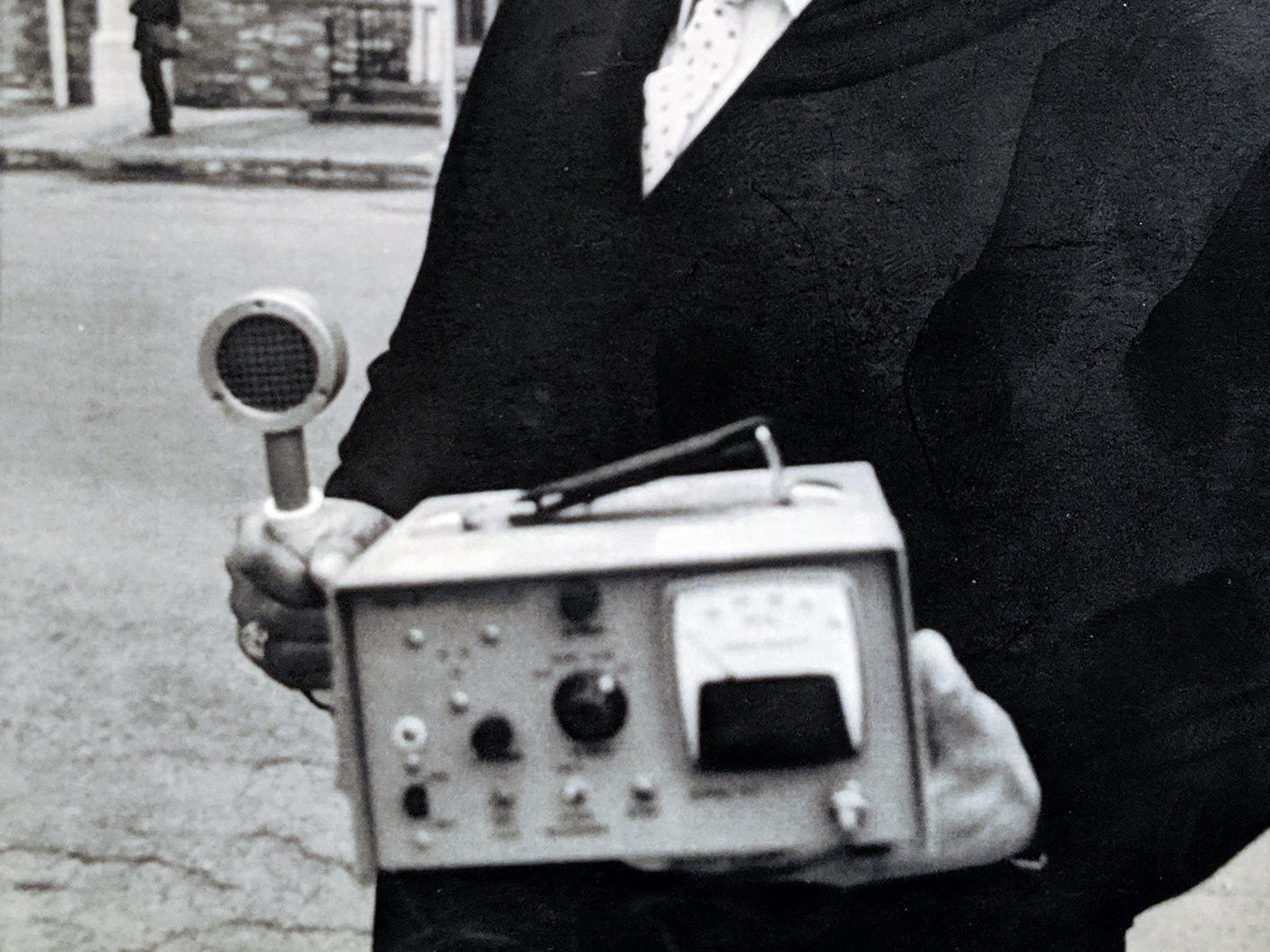Middletown Mayor Robery Reid stands outside the borough hall with a portable radiation monitor given to him by General Public Utilities Corp. for use in the town, which sits in the shadow of Three Mile Island, on March 16, 1979.