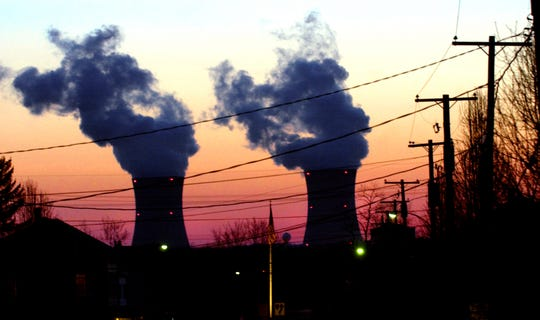 The TMI cooling towers are seen from Goldsboro, Pa. during sunrise on  March 24, 2004.