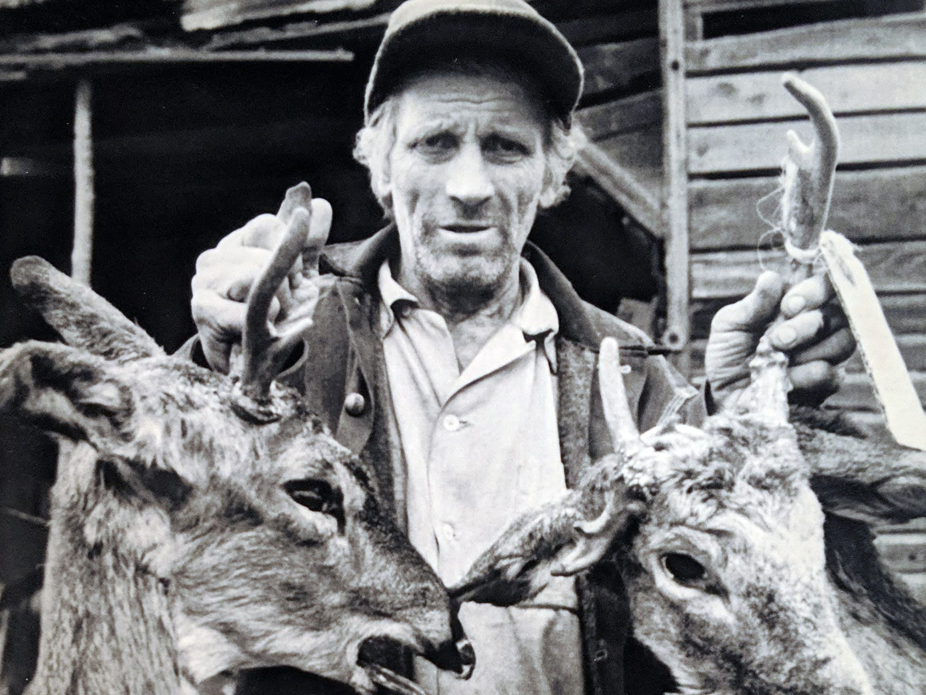 On the tenth anniversary of the Three Mile Island anniversary in March 1989, Paul Halowka, of Zion View, displays two deer whose antlers he believes were disfigured as a result of the nuclear incident.