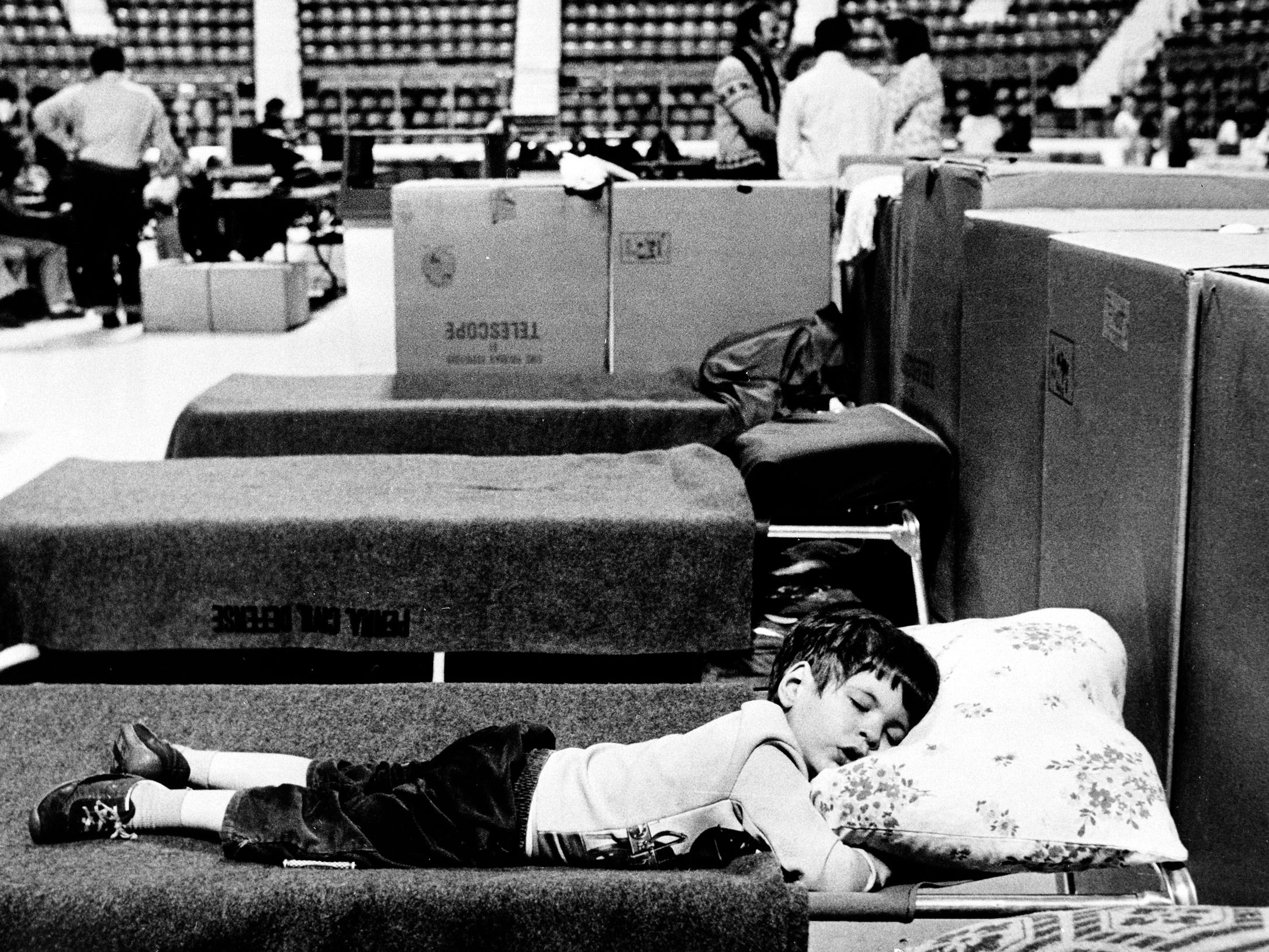 Bobby Phillips of Middletown, age 3 on April 2, 1979, takes a nap at Hersheypark Arena during the Three Mile Island scare. The arena was set up as an evacuation center during the incident.