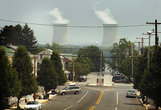 The cooling towers at Three Mile Island Nuclear power plant command the eastern sky in Goldsboro in August 2002.