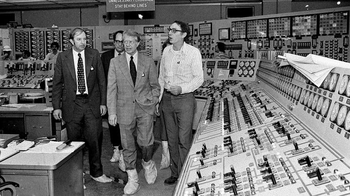 Wearing protective boots, then President Carter, center right, accompanied by Dr. Harold Denton, then Director of the U.S. Nuclear Agency, left, and then Pennsylvania Gov. Dick Thornburg, left-rear, tour the control room of the Three Mile Island nuclear plant in Middletown, Pa. on April 1, 1979, four days after the nuclear accident.