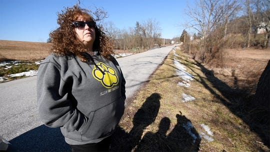 Carolyn Cooksey, the stepdaughter of suspected murder victim Thomas Hayden, stands in an area in Conewago Township, York County, Pa., recently where a FoodSaver bag was found in 2012 containing DNA that matched Hayden.