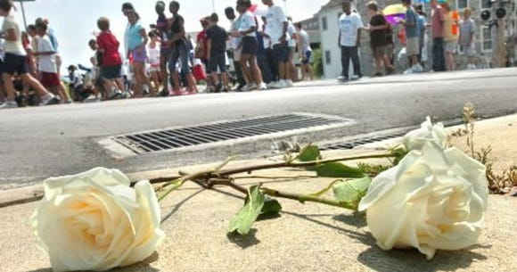 These roses, placed during 2009's Unity March, are placed at the Newberry Street railroad crossing site where Lillie Belle Allen was shot and killed in 1969 during the race riots in York.