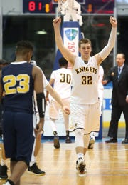 McQuaid's Connor Zamiara celebrates as the final buzzer sounds in their Section V Class AA championship victory over UPrep 81-75. McQuaid will play in the fifth and final state quarterfinal game at 8:15 p.m. Saturday at Greece Athena.