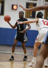 Bishop Kearney's Lytoya Baker looks for an open player.