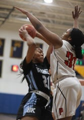Bishop Kearney's Saniaa Wilson drives to the basket and shoots over Penfield's Nyara Simmons.