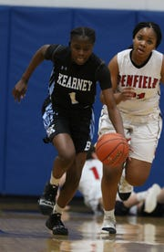 Bishop Kearney's Lytoya Baker races to the basket getting past Penfield's Nyara Simmons during the Section V girls basketball finals held at Victor High School on March 2. Kearney defeated Frontier in the state Class AA quarterfinals on Saturday.