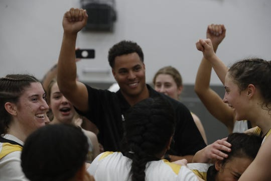 Enterprise players crowd coach Anthony Williams after the Hornets' 56-49 win over Cosumnes Oaks in the regional semifinals of the Division II state playoffs on Saturday, March 2.
