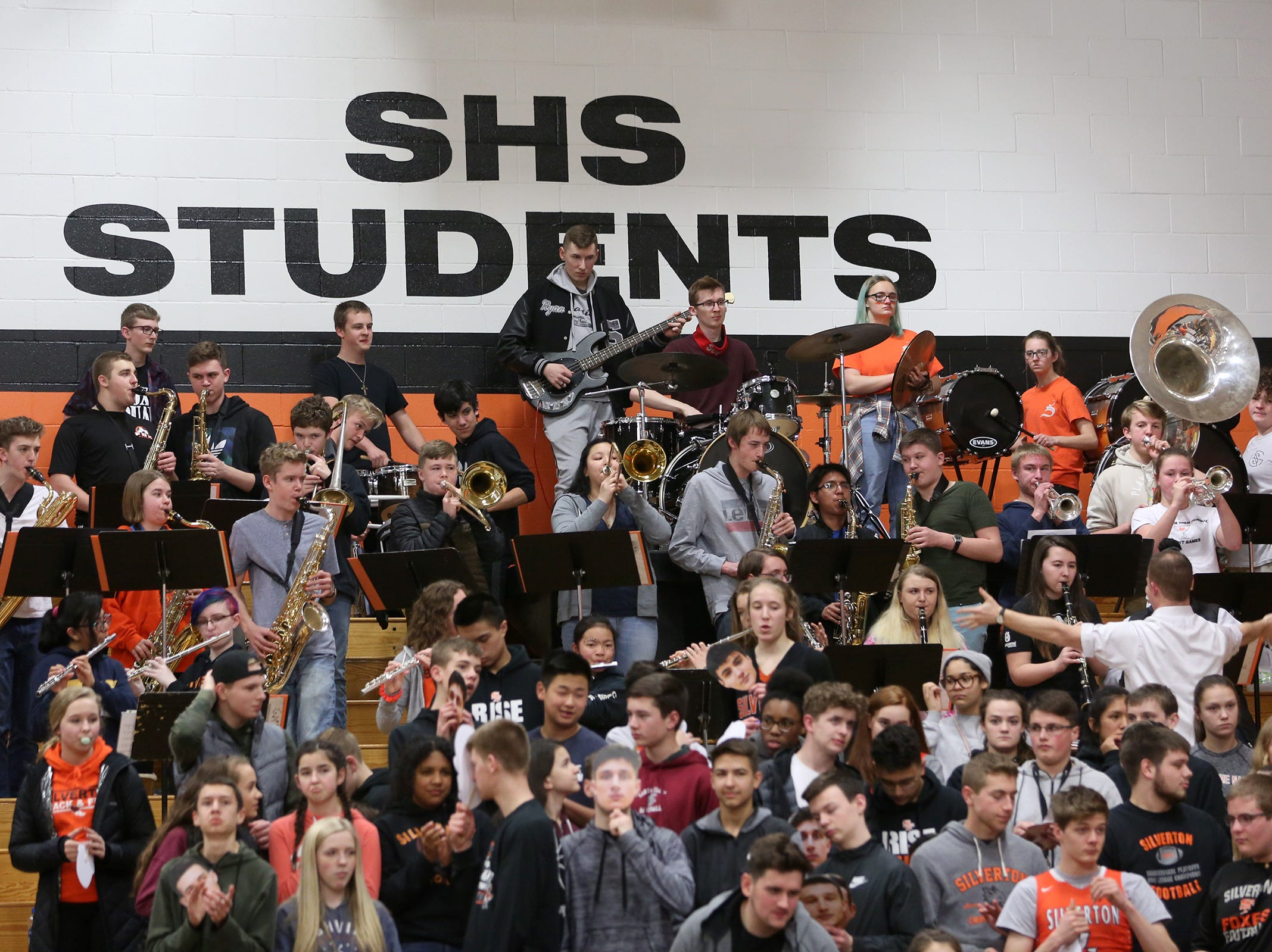 Silverton's band performs during the Silverton vs. Springfield boys basketball OSAA state playoffs game at Silverton High School in Silverton on Saturday, March 2, 2019.