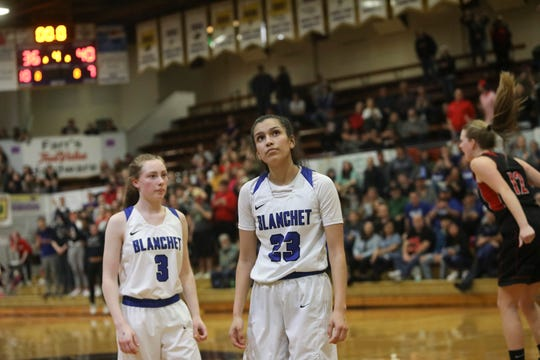 Blanchet Catholic's Ana Coronado (23) looks up at the scoreboard after making a last-second three-point basket at the buzzer, bringing them within one point of Clatskanie to end the 3A OSAA State Championship game on Saturday, March 2 at Marshfield High School. Clatskanie won 40-39.